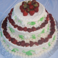 Strawberrie Wedding Cake Made this cake for my cousins wedding, it is french vanilla and I mixed strawberries in the cake mix. I made a strawberry icing in between...