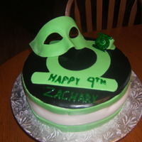 Green Lantern B-Day Cake Made this cake for a green Lantern fan. I had no idea what this was till I made the cake. So hopefully he likes it. I had to Google Green...