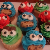 Sesame Street Cupcakes Elmo, Oscar and cookie monster cupcakes for a toddler's birthday party.