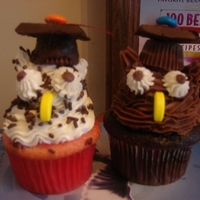Owl Grad Cupcakes graduation owl cupcakes with buttercream frosting. Grad hats are made with reeses cup and chocolate covered graham crackers.