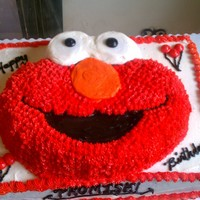 Elmo Wilton's elmo pan on top of a 1/2 sheet cake. All buttercream.
