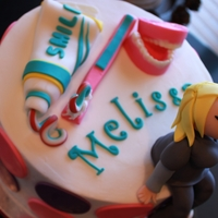 Dental Hygienist Cake Buttercream cake with fondant toothpaste/brush, girl, and chocolate dentures.