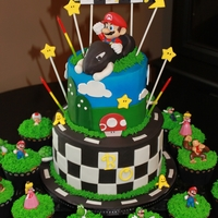 Mario Kart Cake - Version 2 Buttercream frosted cake with fondant and gumpaste decorations and licensed characters/toys