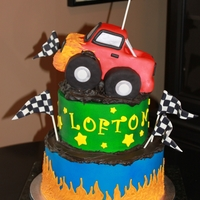 Monster Truck Cake Frosted in buttercream, rice krispie and fondant truck with buttercream flames.
