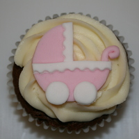 Baby Shower Cupcakes Chocolate cupcake with vanilla frosting and fondant decoration