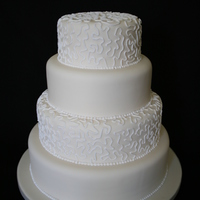 Cream And White Wedding Cake 4 tier wedding cake. Decorated with corneli lace.