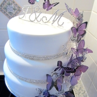 Purple Butterfly Bling Wedding Cake This is my latest cake for a beautiful friends wedding. She LOVES Butterflies, the colour purple and anything shiny or bling!We have two...
