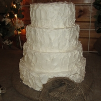 "Burlap Theme Wedding Cake The bride wanted a textured buttercream. She also made the burlap flower to be put into it. Made sure I took pictures with out the ""..."