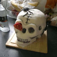 Vampire Skull Cake Strawberry cake with banana frosting, covered with sugarpaste. There rose in one of the eye sockets was a request and I thought the spiders...