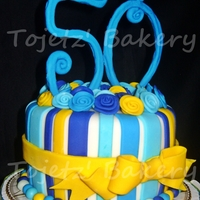 "Blue And Yellow Bow And Roses Cake An all edible 6"" fondant cake in all shades of blue accented with a yellow ribbon. TFL :)"