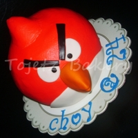 "Red Angry Bird A 6""x 6"" chocolate cake sculpted to look like a real angry bird!"
