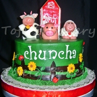 "Chuncha's Barnyard Cake Chuncha's barnyard themed cake. an 8""x4"" chocolate cake in dark forest green buttercream. Cake is decorated with an all..."