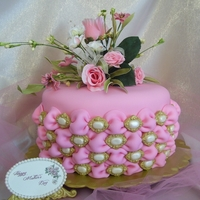Tufted Billow Weave Mother's Day Cake 3 layer Lemon Sour Cream Pound cake with raspberry and butter cream filling, butter cream on the outside and lemon/butter/vanilla flavored...