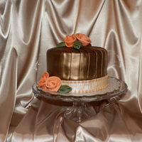 Pleated Bronze And Copper Cake This is a 3 layer Chocolate Mayonnaise cake filled with real butter butter cream vanilla icing and covered with Chocolate MMF. After...