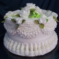 White On White White cake with white butter cream icing, and white butter cream roses. Pearls are made from gum paste and pearl dragees were used on the...