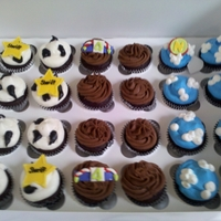Toy Story Theme Cupcakes These cupcakes went with a three tier toystory cake (also posted). The white and blue cupcakes were topped with whip topping, the other are...