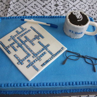 Crossword Puzzle And Accessories Cake for my Father-in-Law's 70th birthday. He is a crossword fanatic. All is edible, except the sentiments on the coffee cup. I'm...