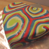 "Groovy Heart Rainbow cake covered in faux tie-dye fondant. I had been requested to make a ""cake with lots of colors in it"".... :D"