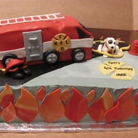Firetruck Cake Cake truck covered in fondant. All other decorations are fondant.