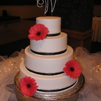 Black And Coral Cake With Bling Buttercream iced, fresh flowers