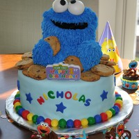 Cookie Monster First Birthday Cake This is a picture of the Cookie Monster cake I made for my son's first birthday. The cookie monster is made of pound cake with butter...