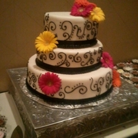 White Fondant With Black Scrolling And Bright Gerbera Daisies