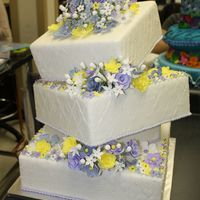 Wedding - Crooked Cake Final Project for Colette Peters Advanced Course. 3 Tier Topsy Turvy quilted cake. All flowers are hand-formed gum paste. Bottoms borders...