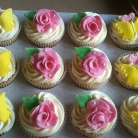 Cupcakes Vanilla sponge and butter cream flowers and butterflies are made from fondant
