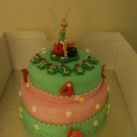 Tinker Bell Cake Chocolate cake with ganache fillings,fondant icing and i got the toppers from ebay