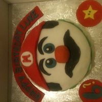 Mario Cake Chocolate cake with chocolate buttercream filling, fondant icing