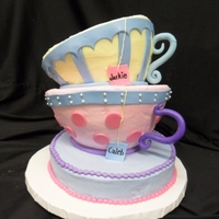 Topsy Turvy Tea Cups  My first topsy turvy cake just 2 months into decorating. YIKES! The handles are made out of fondant. The cups are made using the soccer...