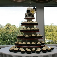 Damask Wedding Cupcakes Red Velvet and Vanilla Bean cupcakes filled with Chocolate Ganache and topped with White Chocolate Cream Cheese Frosting, adorned with a...