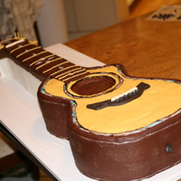 Taylor Guitar Cake I made this cake for a very musical family that we know, for their son's wedding. It was designed after the Taylor 914 Guitar....