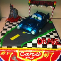 Finn Mcmissle Cake 3D Cars 2 Finn McMissle cake covered in fondant, decorated with gum paste, modeling chocolate, and BC. Finn sculpted from rice cerael treat...