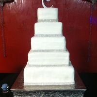 Simple Yet Elegent   Four tier wedding cake with rhinestone trim. The bottom tier was a dummy cake made of styrofoam and covered in fondant.