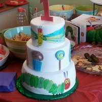 The Hungry Caterpillar The first and third tier are hand painted. The second tier decorations are made from fondant. For my nephew's first birthday.