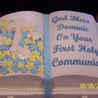 First Communion Cake Half sheet, pound cake with buttercream frosting and chocolate mousse filling. Book cake, pound cake with buttercream frosting and bavarian...