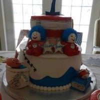 Thing 1 And Thing 2 Twin's first birthday. Buttercream on cake (blue, white, red). Figures and hat stripes are fondant and gum paste mix. Inspired by...