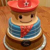 Cowboy Little People Buttercream covered, with fondant accents - belt/buckle, bandana, hat.