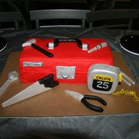 Tool Box Cake This is my 7th cake. I made it for my husband's birthday. The tools are white chocolate painted with luster dust and handles covered...