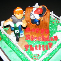 Skateboarder And Cicylist The characters are fondant and candy mix, bike and skateboard is melted and carved candy, fence is candy covered pretzels.