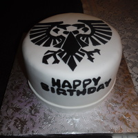 Warhammer Cake  Sometimes less is more. Here's the first cake of 2015, a Warhammer theme. The logo is from this table top game, the Imperial eagle....