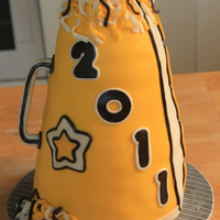 Cheerleader's Megaphone Made for the local high school's Cheerleader banquet. Mixed chocolate and vanilla layers with white chocolate ganache and MMF.