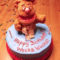 Fozzie Bear Ice Cream Cake Fozzie Is Made Of Krispie Treat Mixture Dyed For Color Features Are Modeling Chocolate And Tootsie Rolls Ca  Fozzie Bear Ice Cream Cake. Fozzie is made of Krispie Treat mixture dyed for color. Features are modeling chocolate and Tootsie Rolls. Cake...