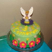 Tinkerbell My granddaughter wanted Tinkerbell for her birthday. She helped make the fondant flowers. WASC with raspberry filling, whipped icing and...
