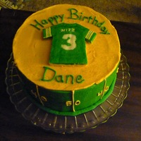 Packer Jersey Birthday 3yo birthday cake with Green Bay Packer theme. Frozen bc transfer attempt with jersey, but I made it too thick. Lesson learned.WASC cake...