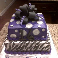 Silver And Purple Sweet 16 Silver buttercream with black zerbra stipes on the first layer. Purple buttercream with silver polka dots on the second layer. All topped...