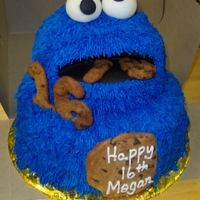 "Cookie Monster Cake Yellow cake, bc icing, fondant eyes & mouth. Used the ball pan for the head & 8"" round 2-layer for bottom."