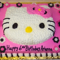 Hello Kitty Cake Chocolate cake, vanilla bc icing., fondant flowers