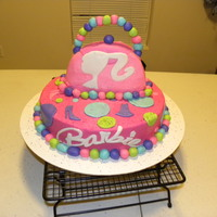 Barbie Buttercream frosting with marshmallow fondant decorations.